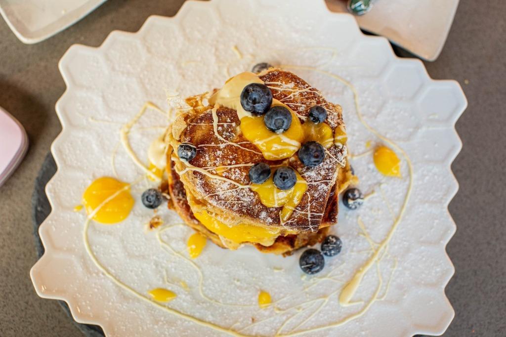 Lemon & blueberry pancake stack aerial view